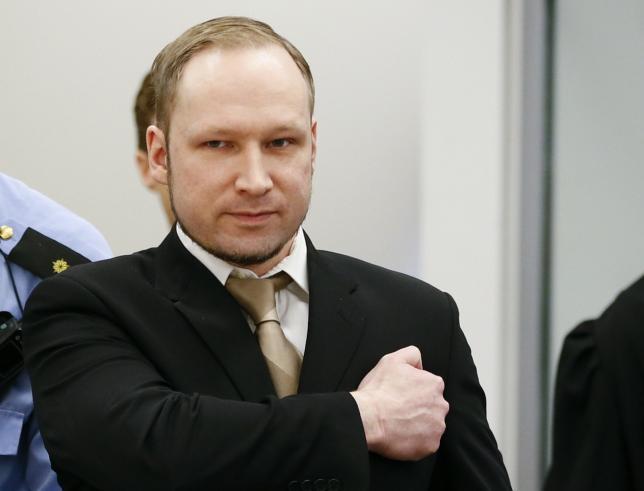 Norwegian mass killer Breivik gestures as arrives in courtroom in Oslo