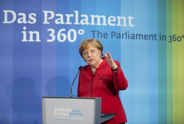 German Chancellor Merkel delivers an opening speech at the Europa Experience exhibition in the European House in Berlin