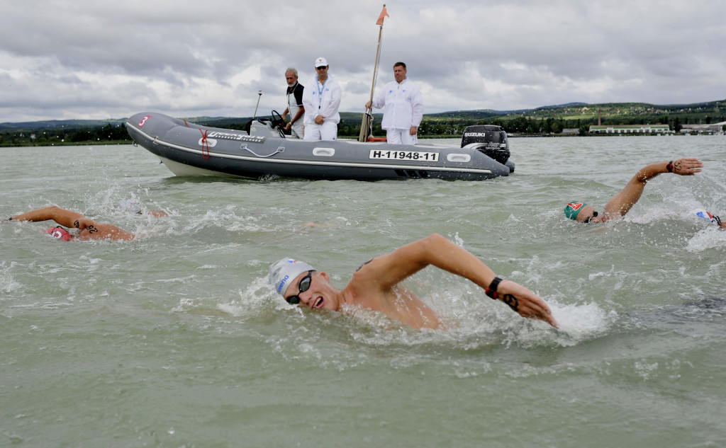 Libor Smolka of Czech Republic, front, competes during the men's 25km open water race of the European Swimming Championships at the lake Balaton offshore of Balatonfuered, Hungary, Saturday, Aug. 7, 2010.<div class='article-ad'><script async src=