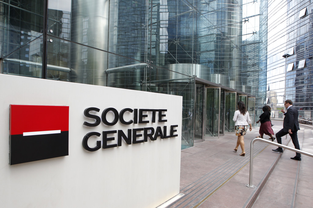 People enter the headquarters of French bank Societe Generale at La Defense, west of Paris