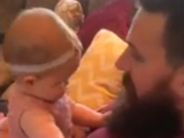SOCIAL-Baby-girl-reacts-badly-after-dad-shaves-off-beard