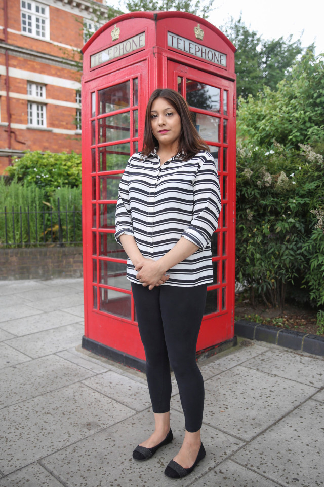 Kiran Sheikh, 22, standing next to a telephone box in Pimlico, Central London. Kiran was dumped in a telephone box as a baby. See SWNS story SWPHONE; A young woman is searching for the kindhearted stranger who rescued her after she was dumped as a baby - in a TELEPHONE BOX. Kiran Sheikh, 22, was just two hours old when she was abandoned by her mother on April 30 1994 in the middle of the night. The frightened mum, who already had six children, was in a violent relationship. After giving birth alone on her bathroom floor, she wrapped her little girl in blankets and ran with her to a nearby phone box.She then called Samaritans and begged them to come quickly before leaving the tiny baby on a street corner, in Newham, east London. The charity workers promised they would come, but before they got there the child was discovered by a man wanting to use the phone to call home.