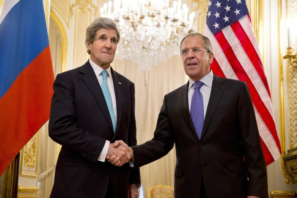 U.S. Secretary of State Kerry shakes hands with Russian Foreign Minister Lavrov at the Russian Ambassador's residence in Paris
