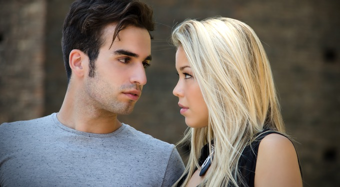 Attractive couple in love looking into each other's eyes