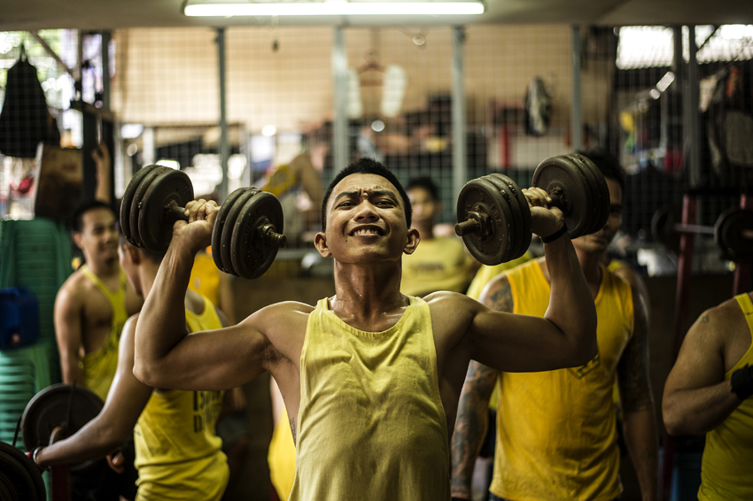 Inmates workout at a gym inside the Quezon City Jail in Manila in this picture taken on July 18, 2016. There are 3,800 inmates at the jail, which was built six decades ago to house 800, and they engage in a relentless contest for space. Men take turns to sleep on the cracked cement floor of an open-air basketball court, the steps of staircases, underneath beds and hammocks made out of old blankets. / AFP PHOTO / NOEL CELIS / TO GO WITH AFP STORY: Philippines-politics-crime-jails, FOCUS by Ayee Macaraig
