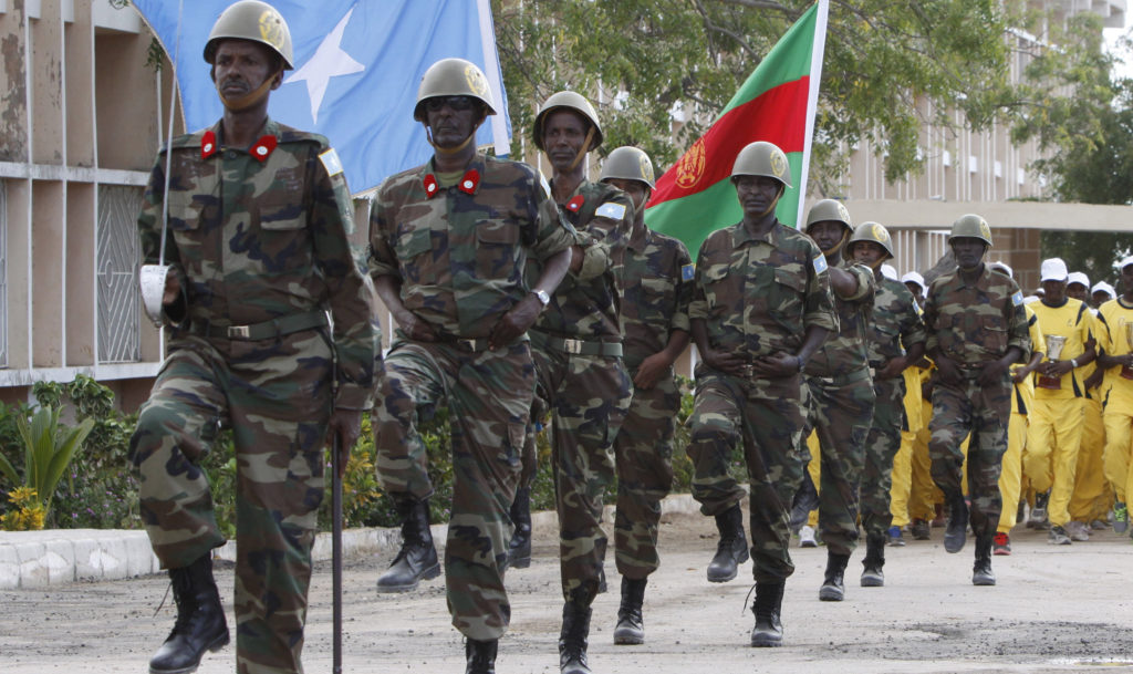 Somali military march at a Ministry of Defense compound during celebrations on the 55th anniversary of the Somalia force in Mogadishu, Somalia, Sunday, April 12, 2015. (AP Photo/Farah Abdi Warsameh)
