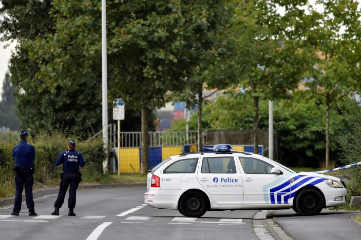 Belgian police officers secure a road near the Belgium's National Institute of Criminology after arsonists set fire to it in Brussels, Belgium August 29, 2016.<div class='article-ad'><script src=