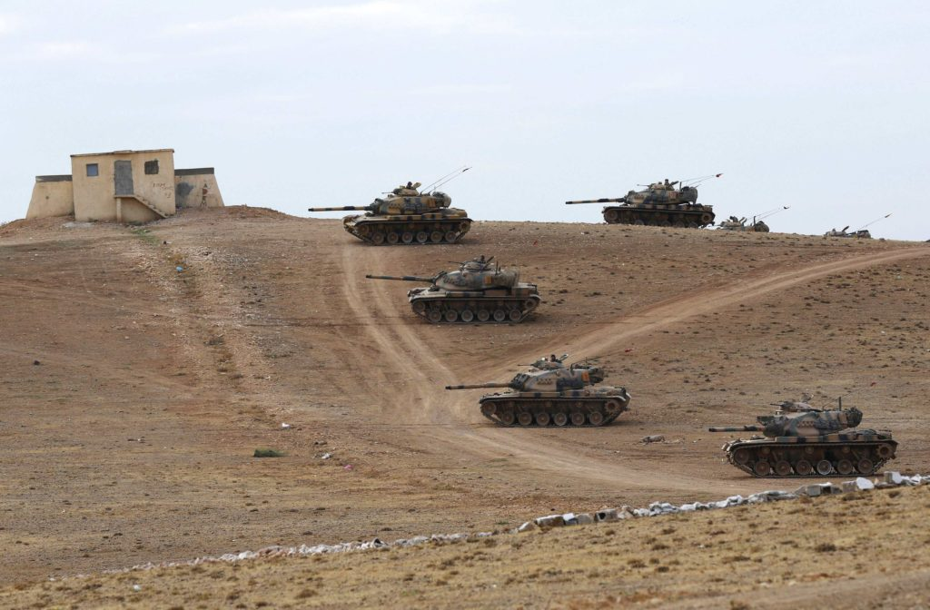 Turkish army tanks take up position on the Turkish-Syrian border near Suruc