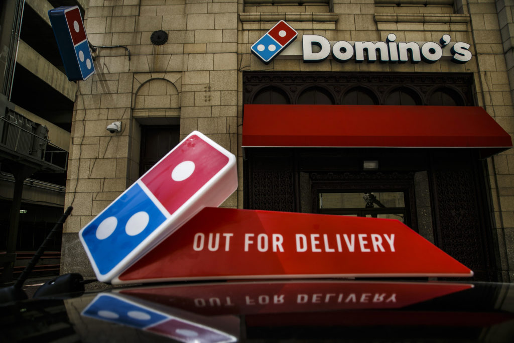 Domino's Pizza Inc. signage is displayed outside of a restaurant in Detroit, Michigan, U.S., on Wednesday, April 27, 2016. Domino's Pizza Inc. is scheduled to release earnings figures on April 28. Photographer: Sean Proctor/Bloomberg via Getty Images