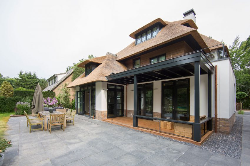 A-stone-paved-patio-stands-right-in-front-of-a-dining-room-inviting-to-continue-dinner-in-refreshing-outdoors