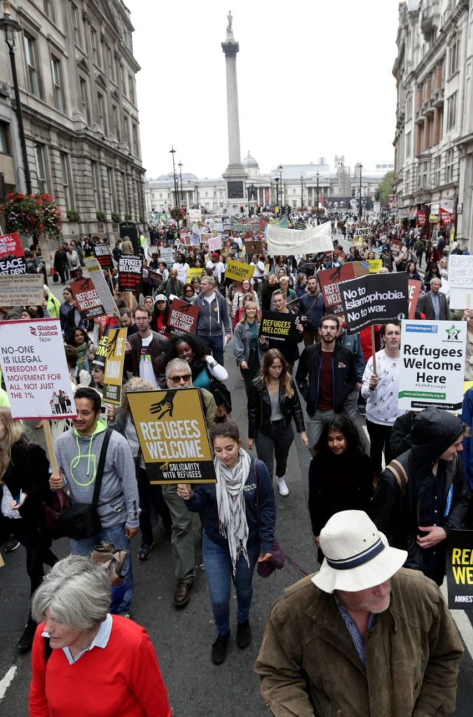 People march through central London as they take part in a protest rally organised by Solidarity with Refugees in a bid to urge the Government to take more action on the migrant crisis. PRESS ASSOCIATION Photo. Picture date: Saturday September 17, 2016. See PA story PROTEST Refugees. Photo credit should read: Yui Mok/PA Wire