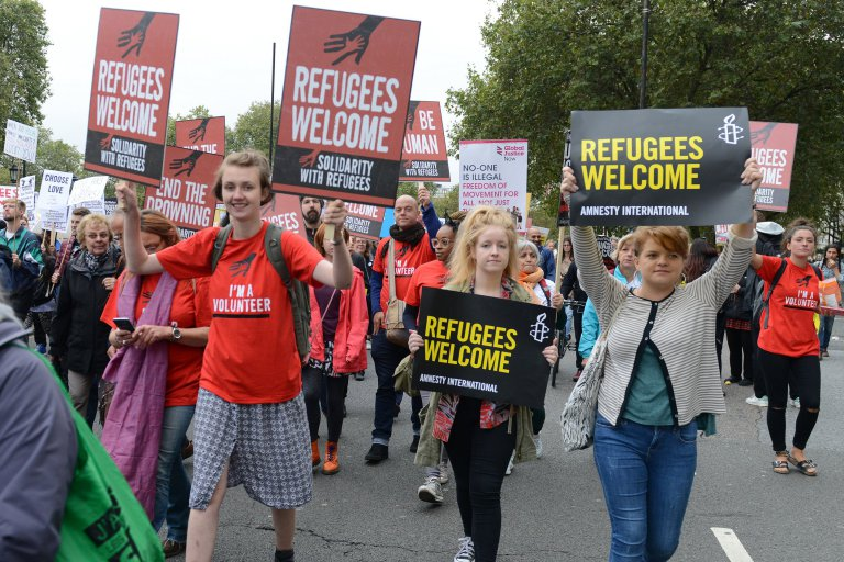 Supporters of migrant refugees march in London ahead of a summit of world leaders in New York to discuss the refugee crisis.<div class='article-ad'><script src=