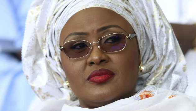"In this photo taken Friday, May. 29, 2015, Nigeria's first lady Aisha Buhari, attends a function in Abuja, Nigeria. Nigeria's first lady has openly questioned her husband's work and said she may not support him if he runs again — comments that President Muhammadu Buhari laughed off, saying, ""I don't know which party my wife belongs to, but she belongs to my kitchen and my living room and the other room."" (AP Photo/Azeez Akunleyan )"