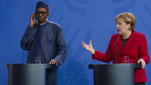 German Chancellor Angela Merkel, right, and the President of Nigeria Muhammadu Buhari brief the media after talks at the chancellery in Berlin, Germany, Friday, Oct. 14, 2016. (AP Photo/Markus Schreiber)