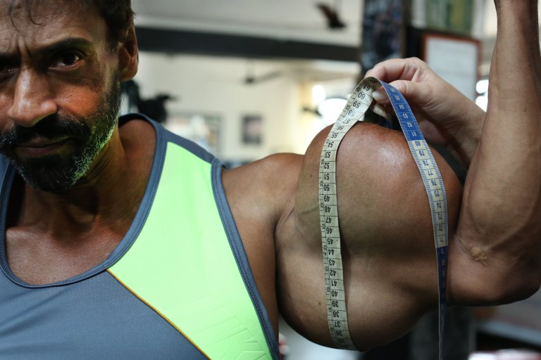 *** EXCLUSIVE - VIDEO AVAILABLE *** SAO PAULO, BRAZIL - OCTOBER 01: Valdir having his biceps measured on October 1, 2015, in Sao Paulo, Brazil. An incredible Hulk-inspired bodybuilder is risking his life to pump up his muscles by injecting oil into his arms. Beefcake Valdir Segatoís huge biceps measure a staggering 23 inches as a result of painful synthol injections.The 48-year-oldís arms have doubled in size from 12in after he began injecting the potentially lethal oil substance five years ago - and now he wants to get even bigger. Valdir, from Sao Paulo, Brazil, is inspired by the physiques of Arnold Schwarzenegger and the Hulk and is proud to be known locally as ëHe-Maní and 'the monsterí in the street. PHOTOGRAPH BY Guilherme LaMotta / Barcroft Images London-T:+44 207 033 1031 E:hello@barcroftmedia.com - New York-T:+1 212 796 2458 E:hello@barcroftusa.com - New Delhi-T:+91 11 4053 2429 E:hello@barcroftindia.com www.barcroftimages.com