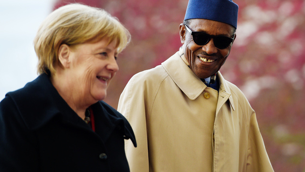 German Chancellor Angela Merkel, left, welcomes the President of Nigeria Muhammadu Buhari, for talks at the chancellery in Berlin, Friday, Oct. 14, 2016.. (Rainer Jensen, dpa via AP)
